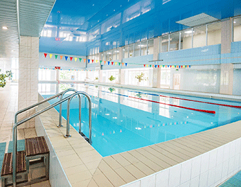 view-of-indoors-swimming-pool-with-metal-ladder-XSB5CJD.png